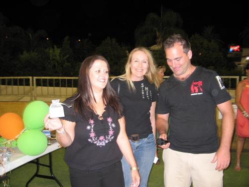 Lucky Twenty20 Singles Cricket prizewinner showing off her SHI Symbol with Chris from SHI Symbol and Sean from Get Hitched