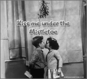 Christmas kiss under the mistletoe